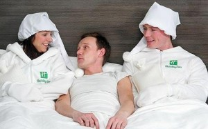 CADDICK/HANDOUT Holiday Inn bed warmers Nick and Jacqui help warm up a bed at one of the hotel mega-chain's U.K. locations.                                                                                                                                                     Photo: CADDICK/HANDOUT