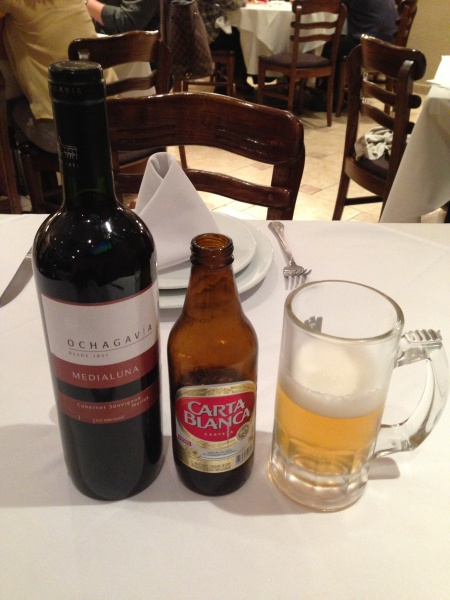 Bottle of red wine and Carta Blanca beer