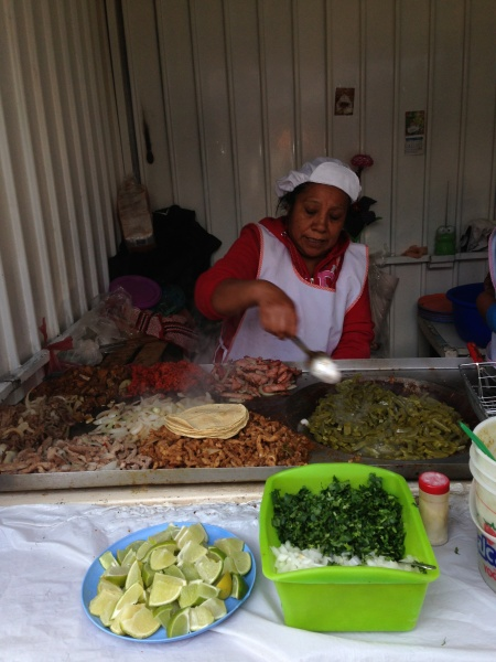 Street vendor selling any type of tacos you want!