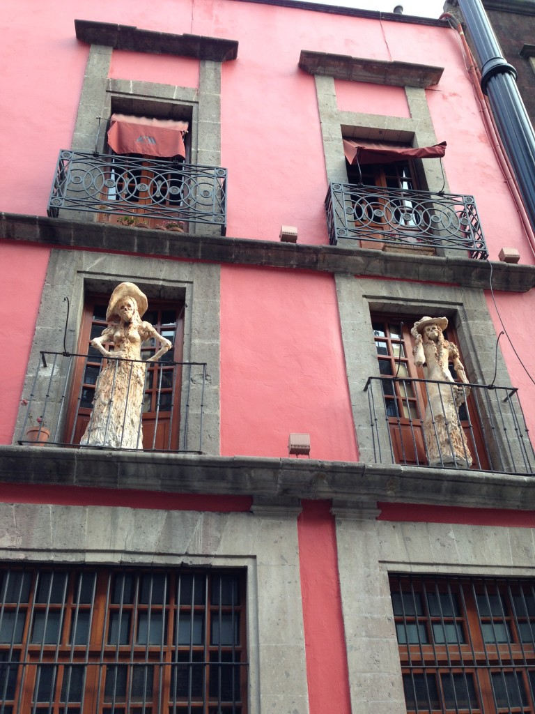 Two skeleton figures near the National Palace