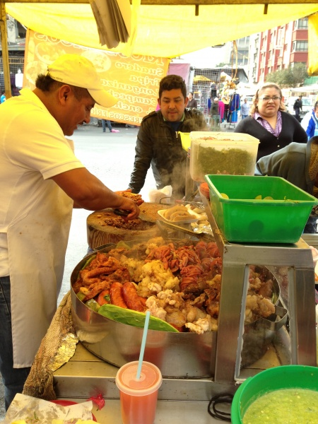 Street vendor selling Mexican seafood dishes
