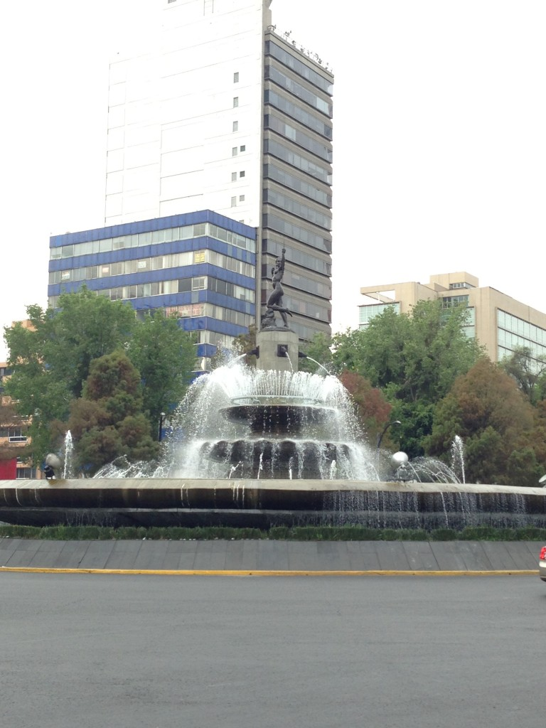 View of a fountain from Paseo de La Reforma in Chapultepec