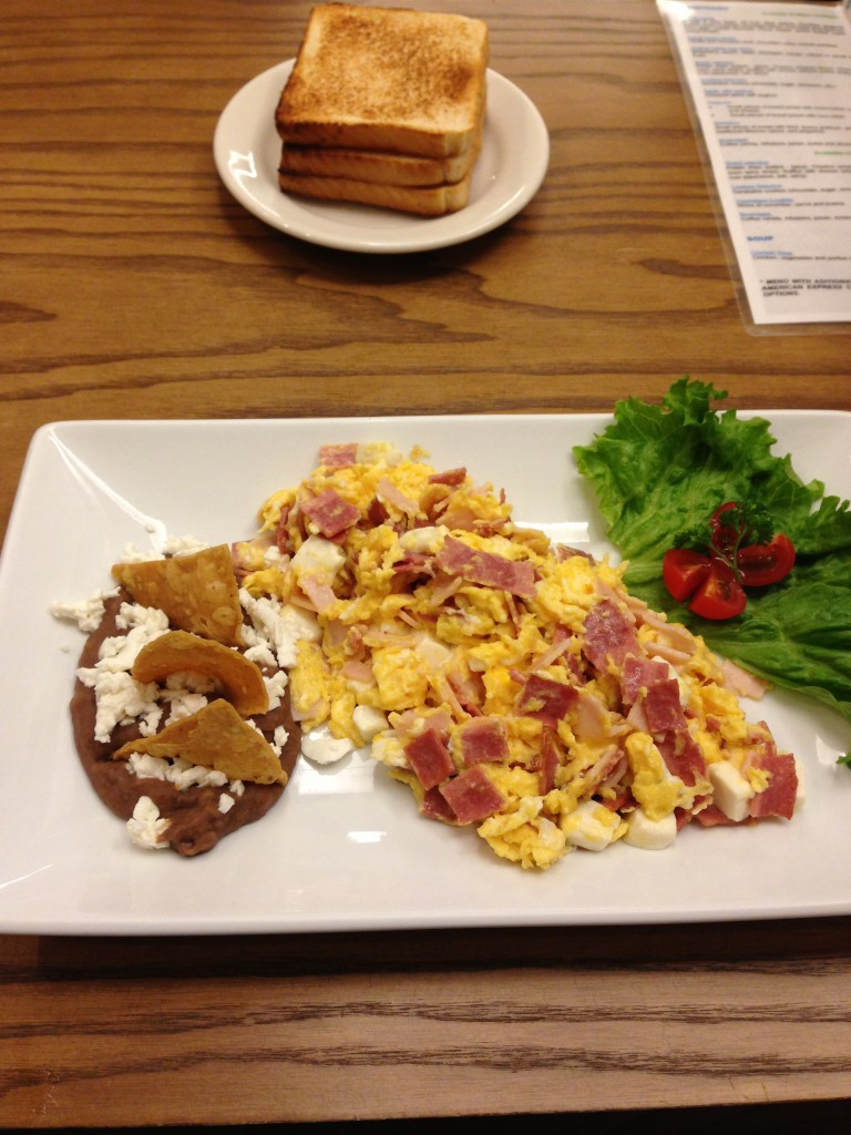 scrambled eggs with ham and refried beans with chips